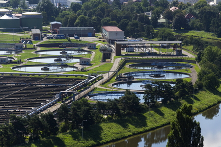 turbid: Aerial view of storage tanks in sewage water treatment plant Stock Photo