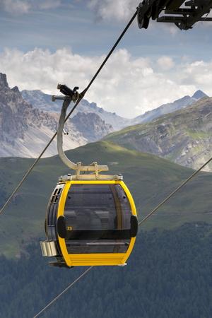 Cable car gondola in Alps mountains near Livigno lake Italy Stock Photo