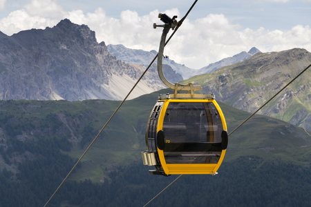 Cable car gondola in Alps mountains near Livigno lake Italy Standard-Bild