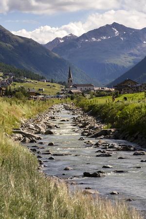 Spol river with church of Santa Maria in Livigno, Italy Stock Photo