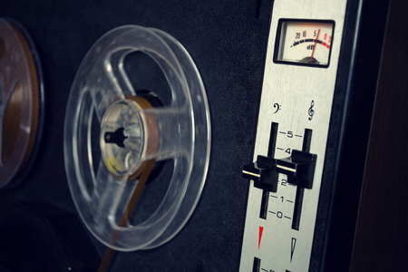 decibel: Filtered vintage picture of reel-to-reel audio recorder
