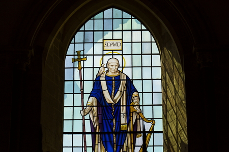 sacred trinity: Saint David on stained glass window in Chichester Cathedral