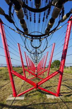 switching: Communication wires lead to switching station from radio transmitter tower