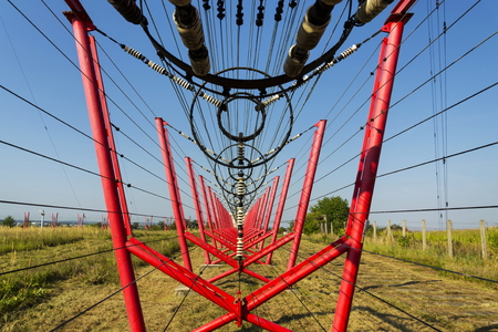 Communication wires lead to switching station from radio transmitter tower