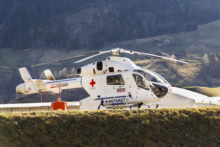 matrei: MATREI, AUSTRIA - MARCH 28: Red Cross medic MD Helicopter MD Explorer by McDonnell Douglas Helicopter Systems stands on heliport on 28 March 2012 in Matrei, Austria. Editorial