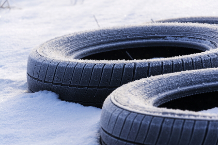 space weather tire: Winter tires on snow on sunny winter freezing day