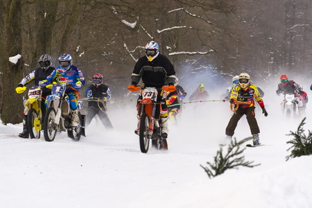 crosscountry: KLASTEREC NAD ORLICI, CZECH REPUBLIC - JANUARY 29: Motorcycle skijoring racers ride on track of Czech championship competition on January 29, 2017 in Klasterec nad Orlici, Czech republic.