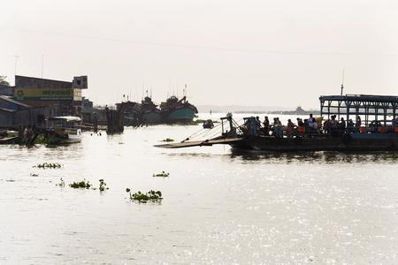 MY THO, VIETNAM - FEBRUARY 13: People crossing Mekong river on ferry on February 13, 2012 in My Tho, Vietnam.