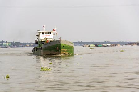 MY THO, VIETNAM - FEBRUARY 13: Boats crossing Mekong river on February 13, 2012 in My Tho, Vietnam.