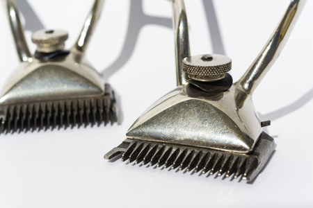 clippers: Vintage hair clippers isolated on white background