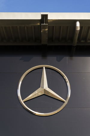 daimler: PRAGUE, CZECH REPUBLIC - FEBRUARY 25: Mercedes-Benz car logo on dealership building on February 25, 2017 in Prague, Czech republic. Daimler does deal with Uber on autonomous vehicles fleet. Editorial