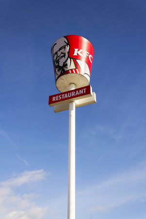PRAGUE, CZECH REPUBLIC - FEBRUARY 25: KFC international fast food restaurant company logo on February 25, 2017 in Prague, Czech republic. KFC launches pizza on a fried chicken base. Editorial