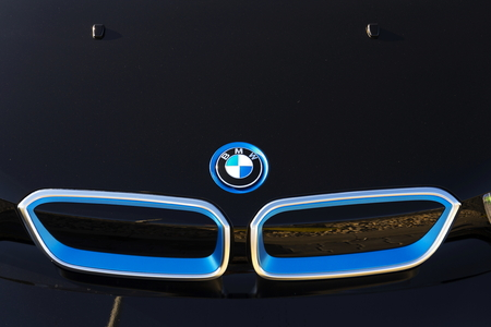 i3: PRAGUE, CZECH REPUBLIC - MARCH 31: BMW i3 car company logo in front of dealership building on March 31, 2017 in Prague, Czech republic. UK BMW workers back strike over pensions.