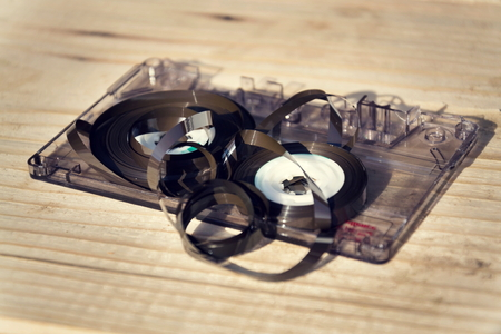 mc: Old broken unwound compact cassette audio tape messed up Stock Photo