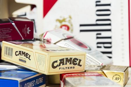 PRAGUE, CZECH REPUBLIC - MARCH 25: Packs of different cigarette brands photographed on March 25, 2017 in Prague, Czech republic. 報道画像
