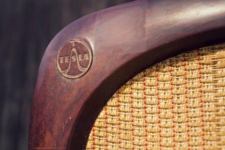 Old brown vintage bakelite Tesla radio on wooden background