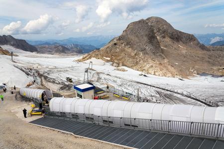 ski walking: RAMSAU AM DACHSTEIN, AUSTRIA - AUGUST 17: Ski lift with people walking to Dachstein glacier on August 17, 2017 in Ramsau am Dachstein, Austria.
