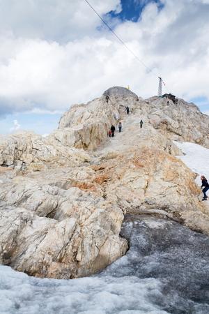 RAMSAU AM DACHSTEIN, AUSTRIA - AUGUST 17: People hiking on Gjaidstein Mountain adventure trail near Dachstein glacier on August 17, 2017 in Ramsau am Dachstein, Austria.