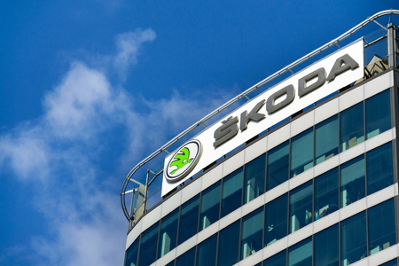 PRAGUE, CZECH REPUBLIC - OCTOBER 14: Skoda Auto automobile manufacturer from Volkswagen Group company logo in front of dealership building on October 14, 2017 in Prague, Czech republic. Skoda plans 5 fully-electric vehicles on sale by 2025. Editorial