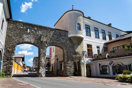 SCHLADMING, AUSTRIA - AUGUST 15: Salzburg Gate in front of Roman Catholic Church on August 15, 2017 in Schladming, Austria.