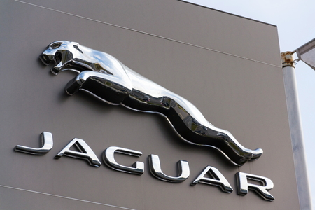 PRAGUE, CZECH REPUBLIC - NOVEMBER 5: Jaguar car manufacturer company logo in front of dealership building on November 5, 2017 in Prague. BlackBerry Ltd. is in advanced talks with Tata Motors Jaguar Land Rover unit to provide the car maker with a software