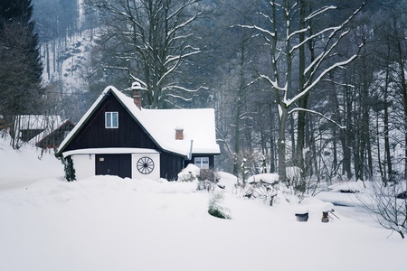 Challet in snowy mountains country, foggy winter day, Czech republic Editorial