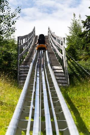 Bobsled Roller Coaster Toboggan in summer day, Rittisberg, Alps, Austria