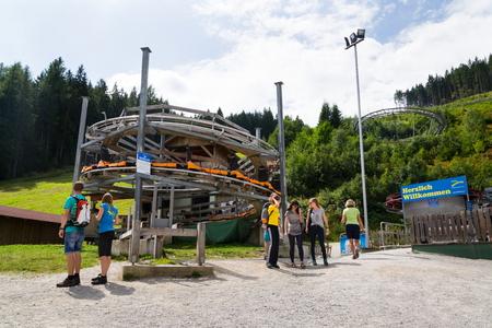 RAMSAU AM DACHSTEIN, AUSTRIA - AUGUST 17: People in front of bobsled roller coaster toboggan in Rittisberg amusement park on August 17, 2017 in Ramsau am Dachstein, Austria. Editorial