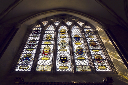 Coats of arms on stained glass window in Chichester Cathedral Editorial