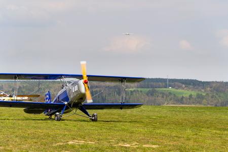 PLASY, CZECH REPUBLIC - APRIL 30: Biplane Bucker Bu-131 Jungmann produced under licence as Tatra T-131 PA on airport runway on April 30, 2017 in Plasy, Czech Republic.