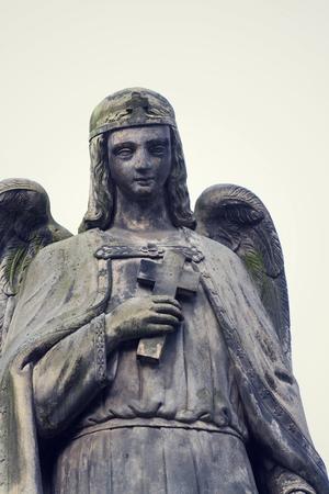 Thinking angel with cross statue, Malostransky cemetery, Prague, Czech Republic