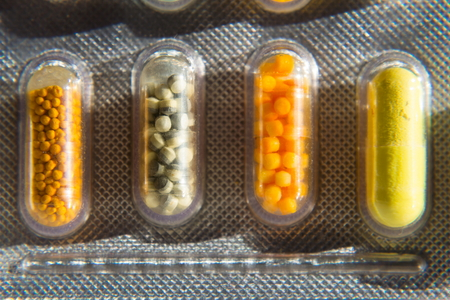 Colorful pills medicine capsule in transparent medicine capsule, illness concept