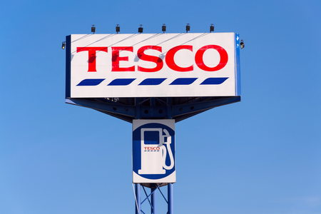 TABOR, CZECH REPUBLIC - FEBRUARY 6 2018: Tesco company logo with gas station in front of supermarket building on February 6, 2018 in Tabor, Czech Republic.