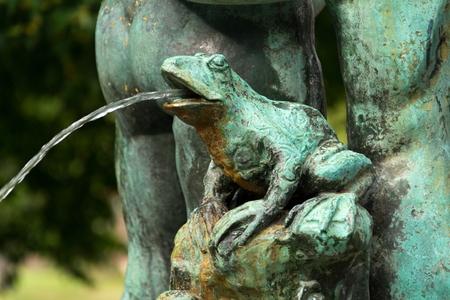 Frog splashing water on fountain, water scarcity concept, Petrin, Prague