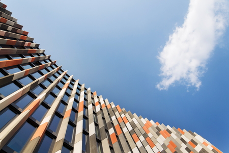 Orange, grey and white brise soleil sun breakers office building