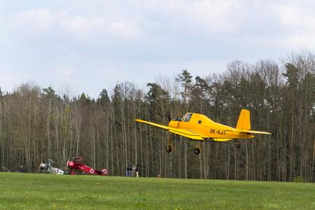 PLASY, CZECH REPUBLIC - APRIL 30: Zlin Z-37 Cmelak Czech agricultural airplane used as crop duster flying on April 30, 2017 in Plasy, Czech Republic.