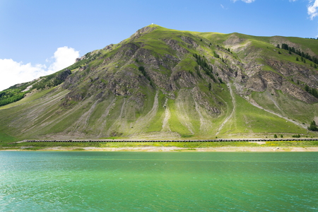 Beautiful summer landscape with Monte Motto and Lake Livigno, Italy