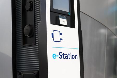 DRESDEN, GERMANY - APRIL 2 2018: Electric car charging station in front of the Volkswagen Glaserne Manufaktur - Transparent Factory on April 2, 2018 in Dresden, Germany.
