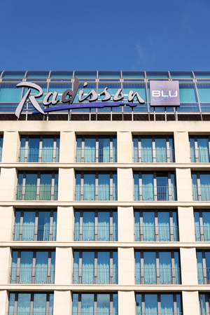 BERLIN, GERMANY - MAY 15 2018: Radisson Blu hotels and resorts logo on the building of hotel on May 15, 2018 in Berlin, Germany.