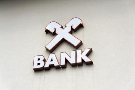 SAALBACH-HINTERGLEMM, AUSTRIA - JUNE 21 2018: Raiffeisen Bank company logo on branch building on June 21, 2018 in Saalbach-Hinterglemm, Austria. Editorial