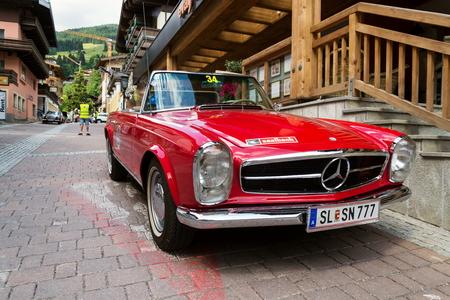 SAALBACH-HINTERGLEMM, AUSTRIA - JUNE 21 2018: Vintage car Mercedes-Benz 230 SL oldsmobile veteran preparing for Saalbach Classic rally on June 21, 2018 in Saalbach-Hinterglemm, Austria.