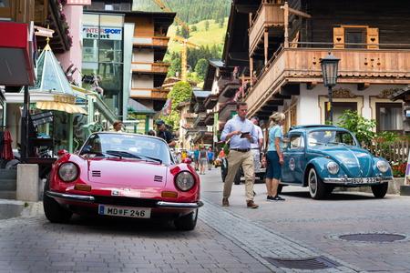 SAALBACH-HINTERGLEMM, AUSTRIA - JUNE 21 2018: Ferrari Dino oldsmobile vintage veteran cars preparing for Saalbach Classic rally on June 21, 2018 in Saalbach-Hinterglemm, Austria.
