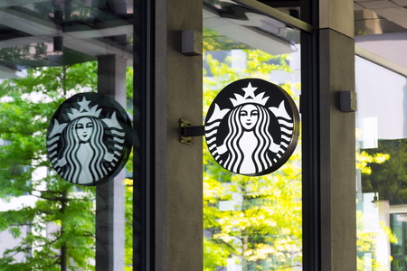 PRAGUE, CZECH REPUBLIC - MAY 19 2018: Starbucks coffee company logo on cafe building on May 19, 2018 in Prague, Czech Republic.