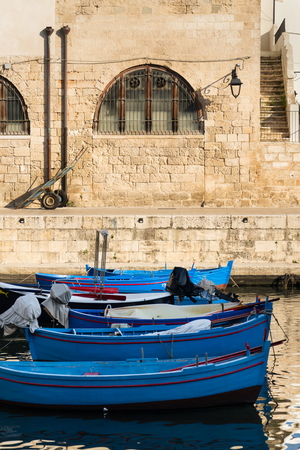 Traditional fishing boats in Monopoli port, Apulia, Bari province, Italy