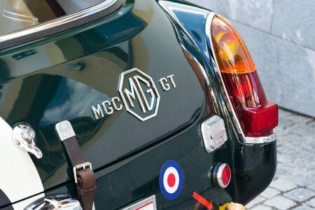 SAALBACH-HINTERGLEMM, AUSTRIA - JUNE 21 2018: Vintage car MG MGC GT coupe oldsmobile veteran stands on June 21, 2018 in Saalbach-Hinterglemm, Austria.