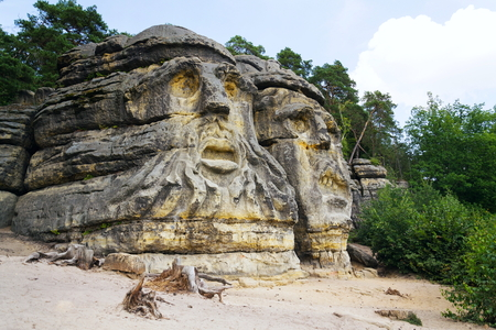 Sandstone rock sculptures Devils Heads near Zelizy, Czech Republic
