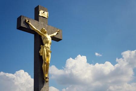 Golden Jesus Christ crucifixion statue, sunny summer day blue sky background, Vrbice, Moravia, Czech Republic Editöryel