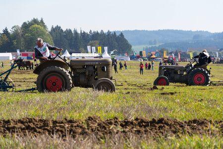KAMENICE NAD LIPOU, CZECH REPUBLIC - OCTOBER 6 2018: Plowing vintage veteran tractors on field on ploughing championship on October 6, 2018 in Kamenice nad Lipou, Czech Republic.