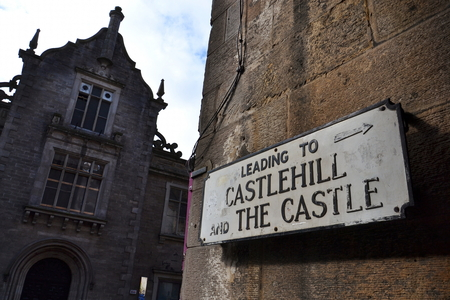 Street sign pointing to the Castlehill and the Edinburgh Castle, Edinburgh, Scotland, United Kingdom, cloudy summer day Editorial