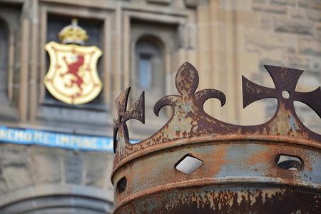 Crown in front of gate to Edinburgh Castle, Royal Stuart coat of arms in background, Scotland, United Kingdom, sunny day Editorial
